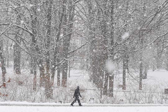 Mike Jones of Rochester hikes around Rochester municipal park early Monday morning on March 23, 2020
