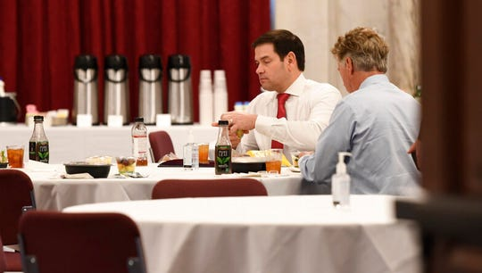 Sen. Rand Paul, R-Ky., right, Sen. Marco Rubio, R-Fla., left, have lunch at a Republican policy lunch on Capitol Hill in Washington, Friday, March 20, 2020. Paul tested positive for the coronavirus.