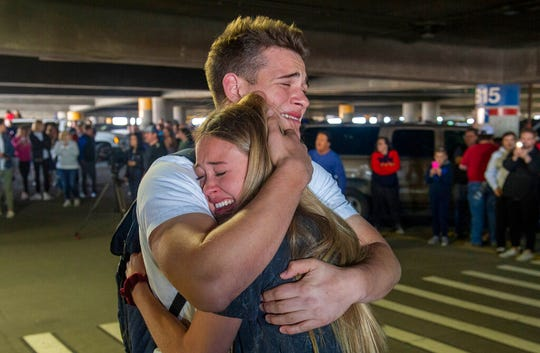 In this Sunday, March 22, 2020 photo, Hope Preston welcomes home her brother Elder Kaleb Preston from his mission in the Philippines, at the Salt Lake City International Airport.