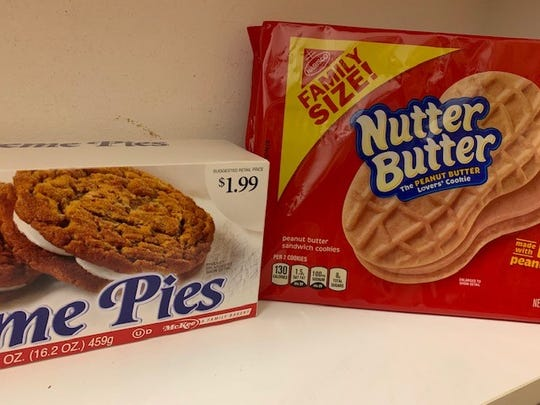 A recent shot of Wojo's cupboard. Hmmm, we would've thought Oatmeal Creme Pies would've been considered too healthy for Wojo.