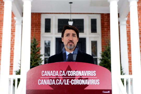 """Prime Minister Justin Trudeau addresses Canadians on the COVID-19 situation from Rideau Cottage in Ottawa on Monday, March 23, 2020. Trudeau says """"enough is enough. Go home and stay home.""""  Trudeau says staying at home is a duty and the government will enforce it if necessary."""