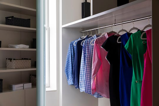 Organizing clothing in color categories or from light to dark can help with organization.
