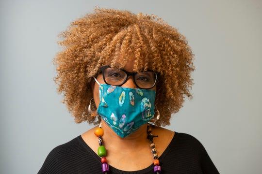 Jocelynn Brown models one of her handmade coronavirus face masks.