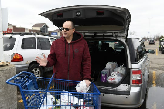 Randy Alexander, 45, of Sterling Heights picked up some more items at Meijer in Warren, Mich. on Monday, March 23, 2020.  Alexander, a skilled trades worker, says he is erring on the side of caution but not going overboard.