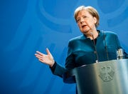 German Chancellor Angela Merkel speaks at a press conference about coronavirus, in Berlin, Sunday, March 22, 2020. Merkel has said she's happy to discuss Italy's request for jointly issued coronavirus bonds to shore up euro members' finances