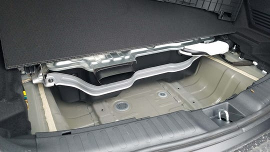 The 1.4 kWh battery for the 2020 Honda CR-V Hybrid is stored under the rear cargo area — taking up space where a spare tire would normally be.
