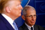 Director of the National Institute of Allergy and Infectious Diseases Dr. Anthony Fauci, right, and President Donald Trump attend a coronavirus task force briefing at the White House, Saturday, March 21, 2020, in Washington.