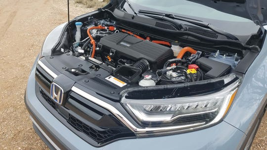 Under the hood of the 2020 Honda CR-V Hybrid is a 2.0-liter 4-cylinder engine mated to an AC motor.