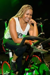 Latricia Wilder, owner of Vibe Ride, a boutique gym in downtown Detroit, isn't bringing in any money during the coronavirus public health crisis that has shut down all gyms across the state.