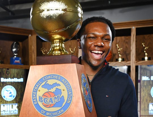 "Carlos ""Scooby"" Johnson of Benton Harbor holds the Mr. Basketball award on Monday."