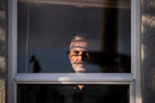 Naples resident Charlie McDonald, 59, stands for a portrait at his home on in late March. He tested positive for the coronavirus and was recovering in self quarantine in his home.