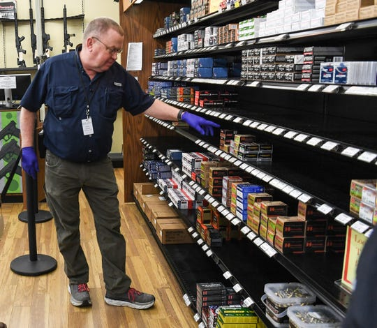 Don Artman of Grady's Great Outdoors in Anderson looks over supplies of ammunition for sale Monday, March 22, 2020.