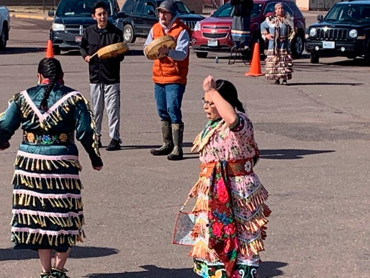 Singers and dancers at a social-distancing powwow outside the Bad River Casino in Ashland, Wis. on Saturday, March 21, 2020. People across Indian Country are organizing online and social-distancing powwows and posting videos of healing dances to offer support during the coronavirus pandemic.