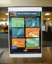 A sign at the Great Falls International Airport asking travelers to help stop the spread of the coronavirus.