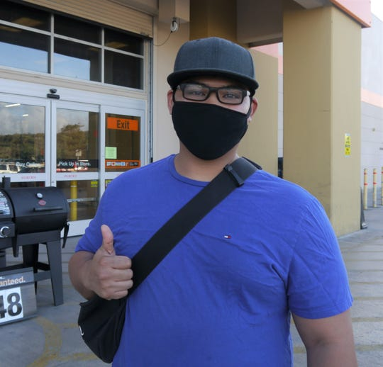 Adrian De Leon found some sanitary supplies early Monday morning, Home Depot, March 23, Tamuning, Guam.