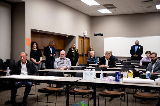 West Tennessee leaders come together but practice social-distancing by spreading apart in the conference room in Jackson, Tenn. Monday March 23, 2020.