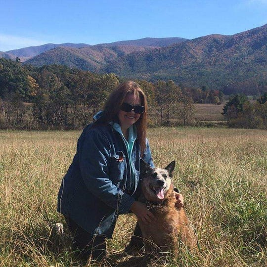 With beautiful mountains in the background, Sharon Boatwright enjoys her job.