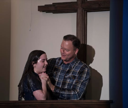 Elder Neal Arwood baptizes his daughter Avery,15, during a Facebook live online service at West Park Baptist Church Sunday, Mar. 15, 2020. Because of a call for social distancing church members were asked stay home and watch the service over the internet.