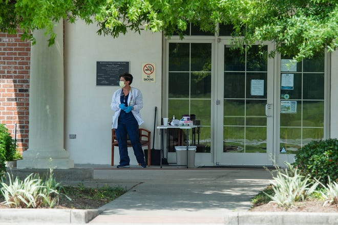Donna Warrington waits outside of the Maurice Community Care Clinic to assist patients on Monday, March 23, 2020.