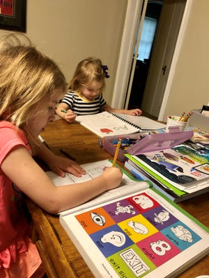 Avery and Marie Guidry continue learning from home while schools are closed to help prevent the spread of COVID-19.