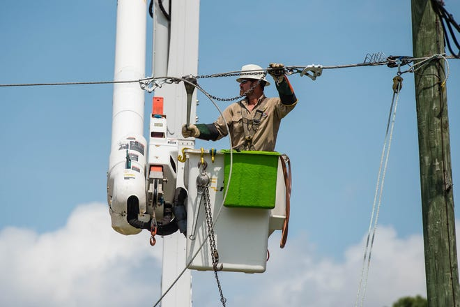 SLEMCO Lineman Durk Baudoin makes repairs to a power line on Highway 167 on Monday, March 23. Utility workers are regarded as essential and asked to report to work as residents are asked to stay home.