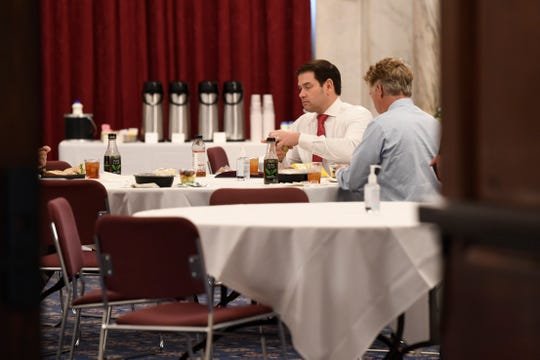 Sen. Rand Paul, R-Ky., right, and Sen. Marco Rubio, R-Fla.,  have lunch at a Republican policy lunch on Capitol Hill in Washington on March 20. Paul tested positive for the coronavirus. (AP Photo/Susan Walsh)
