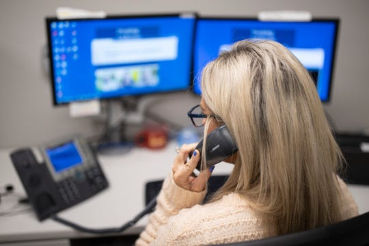 A phone receptionist takes a call at the Suicide Prevention Hotline call center in Louisville on Monday. March 23, 2020