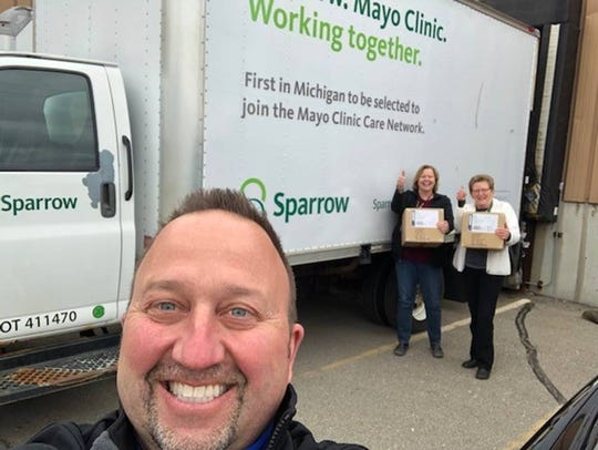 Steven Tomaszewski of General Motors dropping off 4,700 N95 masks for Sparrow Health System.