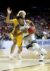 Xavier Tillman of Michigan State drives to the basket against Jarvis Omersa of Minnesota during the first half in the second round game of the 2019 NCAA Men's Basketball Tournament at Wells Fargo Arena on March 23, 2019 in Des Moines, Iowa.