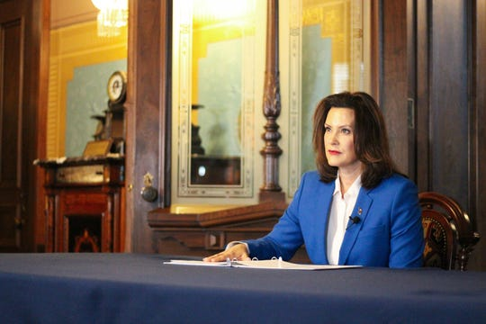 Michigan Gov. Gretchen Whitmer signed an executive order March 23, 2019, requiring most people to stay home to prevent the spread of COVID-19.