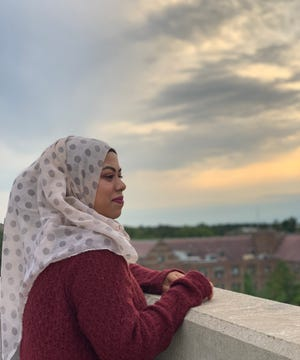 MSU pre-law and humanities senior and Detroit-Cass Tech graduate, Rumana Uddin, looks over MSU's campus. Uddin is a first generation college student whose parents, like many, will have to wait to see her walk at college graduation.