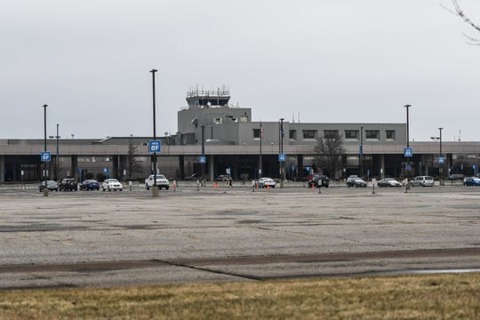 The parking lot in front of Capital Region International Airport, pictured Monday, March 23, 2020, in Lansing, Mich.