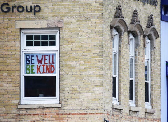 An optimistic sign seen in downtown Manitowoc, Monday, March 23, 2020, in Manitowoc, Wis.