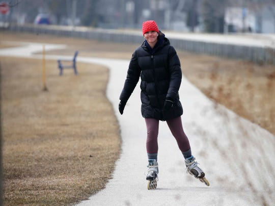 Katie Henry of Manitowoc had Mariner's Trail all to herself as she rollerblades, Monday, March 23, 2020, in Manitowoc, Wis.