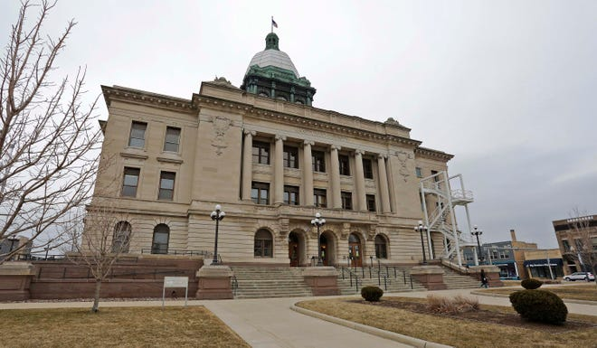 The Manitowoc County Courthouse as seen, Monday, March 23, 2020, in Manitowoc, Wis.