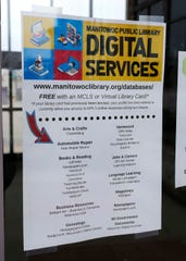 Manitowoc Public Library poster says that some digital services are being reduced, Monday, March 23, 2020, in Manitowoc, Wis.