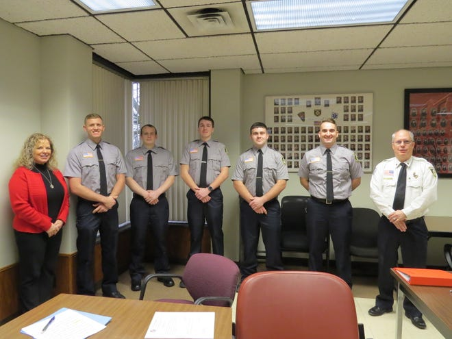 Safety-Service Director Lori Cope and Mansfield fire Chief Steve Strickling flank new firefighters Jason Allen, Tyler Ackerman, Hunter Shoup, Trevor Arnold and Michael Ranalli, who were sworn in Monday.