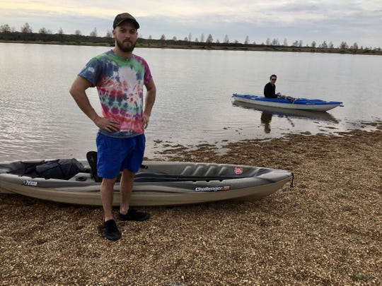 Jacob Allen (foreground) and co-worker Austin Barnett enjoyed kayaking at Shelby Farms on March 23, 2020.