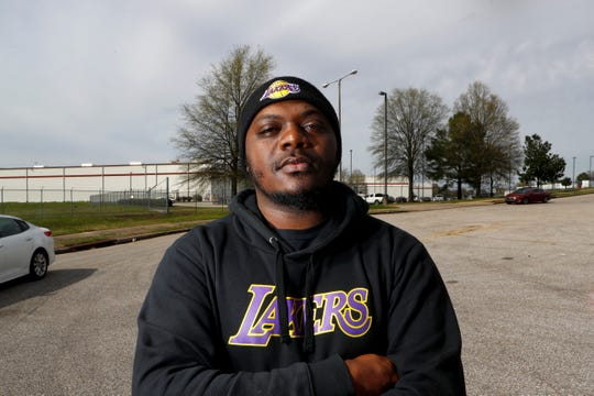 Maurice Wiggins stands outside of the Kroger warehouse supply store before his shift on Monday, March 23, 2020. Workers there are on mandatory overtime, working seven days a week for as much as 16 hour shifts to feed the Mid-South supply chain of grocers.