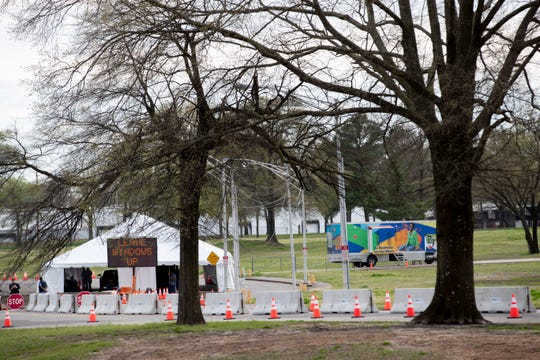 Cones and concrete barricades line the path to the COVID-19 drive-through testing site Monday, March 23, 2020, at the Memphis fairgrounds.