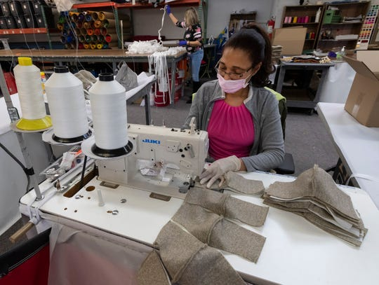 Ana Matéo Carrión sews surgical masks at Eder Flag in Oak Creek as production began last month. Eder Flag, the No. 1 flag and flagpole manufacturer in the United States, and Monterey Mills, a Janesville-based textile mill, teamed up to start manufacturing thousands of masks.