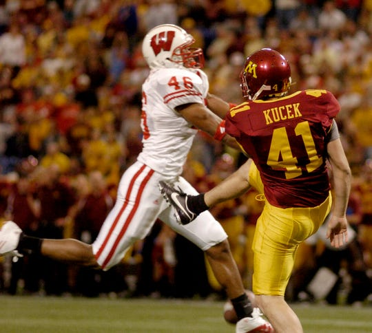 Wisconsin's Jonathan Casillas, left, blocks a punt by Minnesota's Justin Kucek  in the final minute of the fourth quarter Saturday, Oct. 15, 2005. Wisconsin's Ben Strickland fell on the ball in the end zone for the touchdown as the Badgers came from behind to win 38-34 Saturday, October 15, 2005, in Minneapolis.