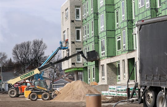 Construction work at 8920 West Orchard Street in West Allis, where work construction of a high-end apartment community called Element 84 is ongoing. New stay at home orders from the Gov. Evers may shut work down on construction projects.