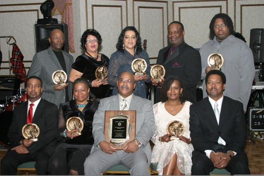 Lenard Wells, front row center, receives an award from the League of Martin in 2008.