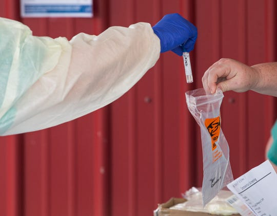 A swab test is stored at the Baptist Health coronavirus testing clinic in Prattville, Ala., on Monday, March 23, 2020.