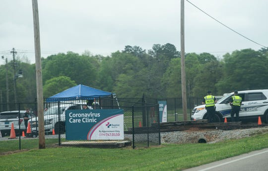 Police guard the entrance to the Baptist Health coronavirus testing clinic in Prattville, Ala., on Monday, March 23, 2020.