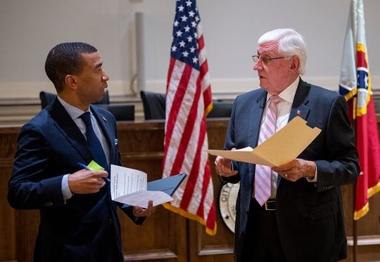 Montgomery Mayor Steven Reed and City Council President Charles Jinright chat after a coronavirus update at city hall In Montgomery, Ala., on Monday March 23, 2020.