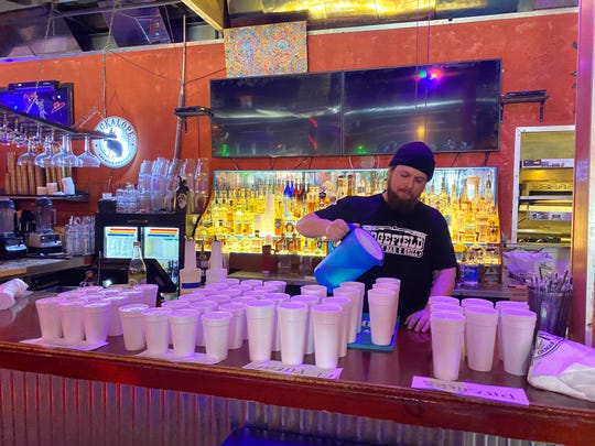 Ben Mitchell, bar manager at Rosepepper Cantina in East Nashville, preps to-go margaritas March 21, 2020, as part of the restaurant's take-out only operation during Nashville's battle against the spread of COVID-19