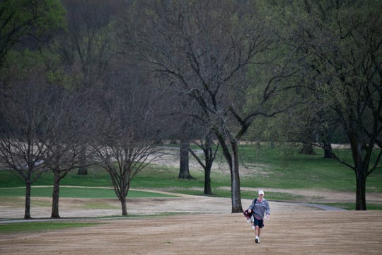 Jack Crawford walks up the 10th fairway as he plays a round of golf at McCabe Golf Course on Monday.