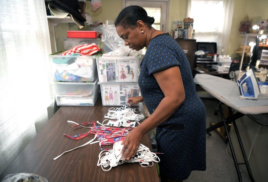 Professional seamstress Doris McMillian makes cotton barrier masks at her Franklin home for healthcare workers at Williamson County Medical Center on Monday, March 23, 2020.  The face mask have a slit so workers can place a filter inside the mask.